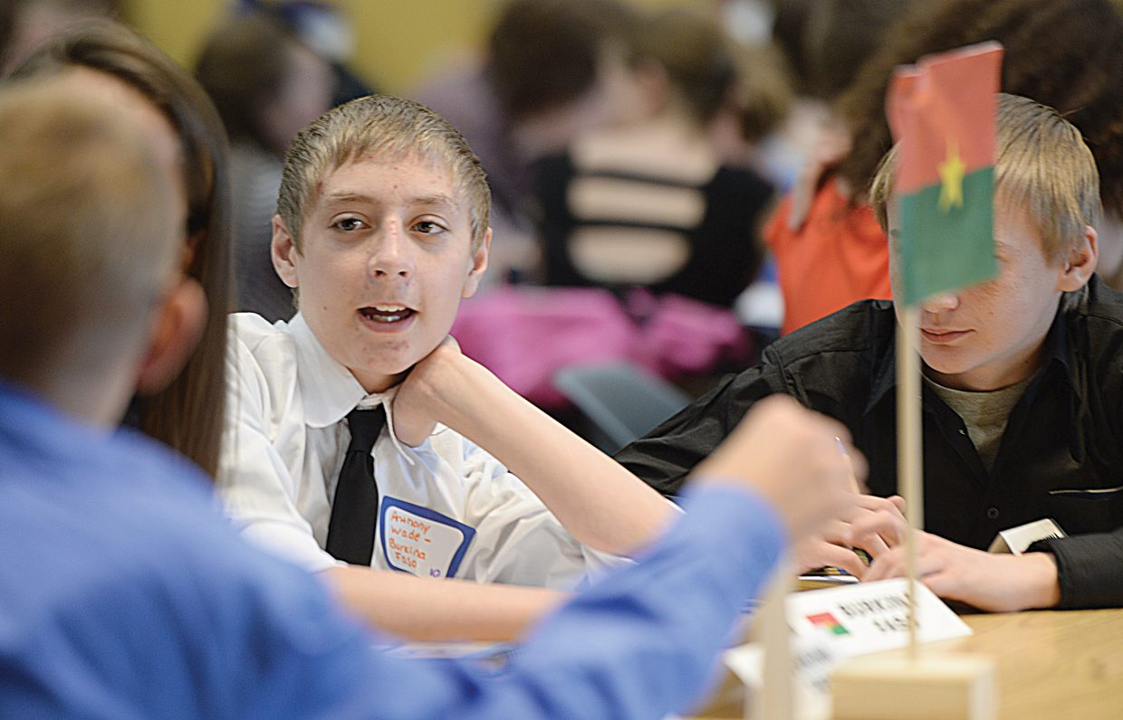 Craig Middle School student Anthony Wade discusses an issue with a classmate during the Model United Nations event on the Colorado Mountain College campus Thursday. Middle school students from Craig, Steamboat Springs, South Routt, Walden, Granby, Fort Collins, Aspen and Eagle/Vail came for the event, which simulates the decision making process of the real United Nations.