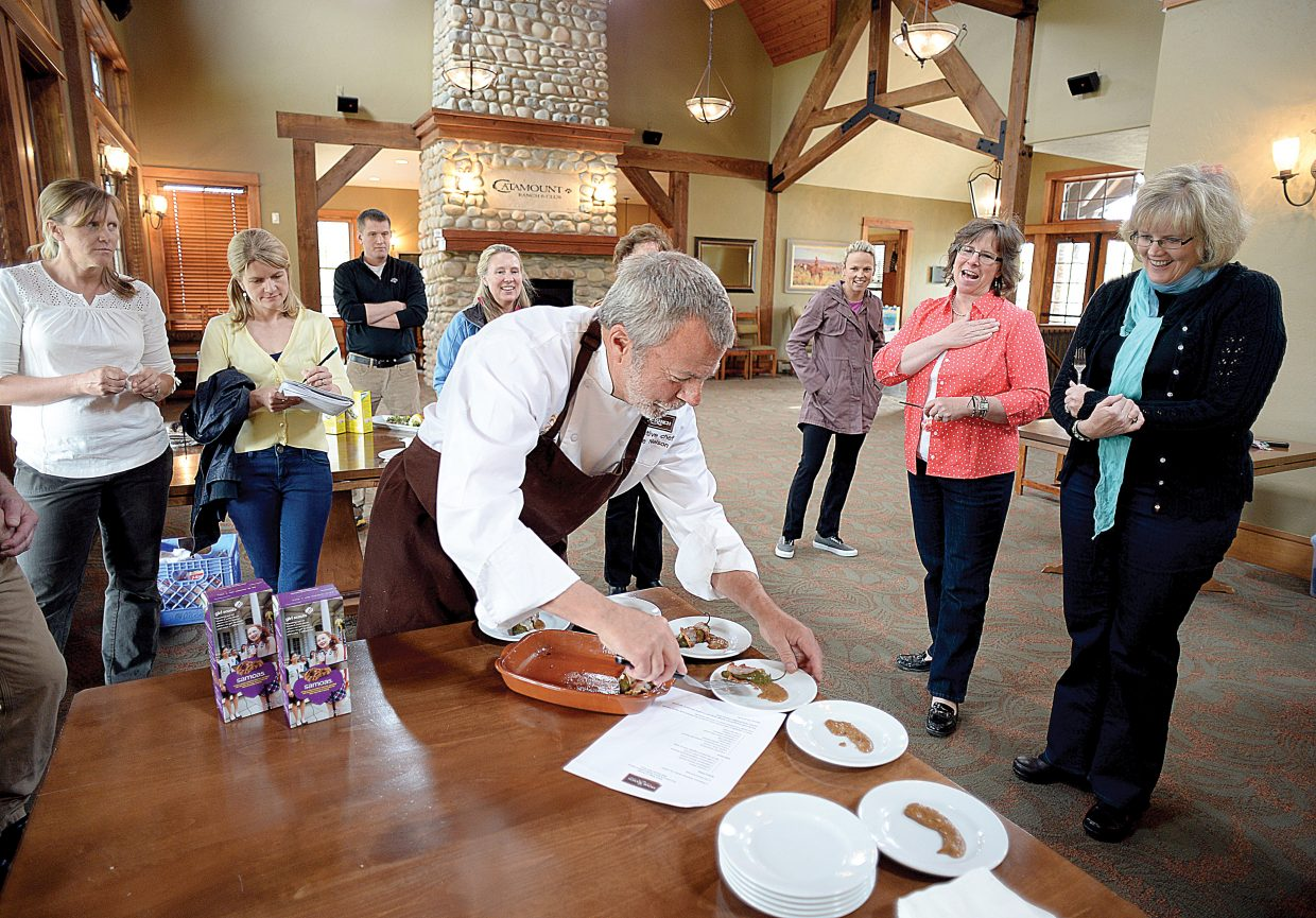 Clyde Nelson, executive chef at the Home Ranch, plates the dish he made using Samoas for a taste test by the committee for the Cookies and Cocktail Creations fundraiser, which will take place May 22 at the clubhouse at Catamount Ranch & Club. The fundraiser benefits local Girl Scout troops.