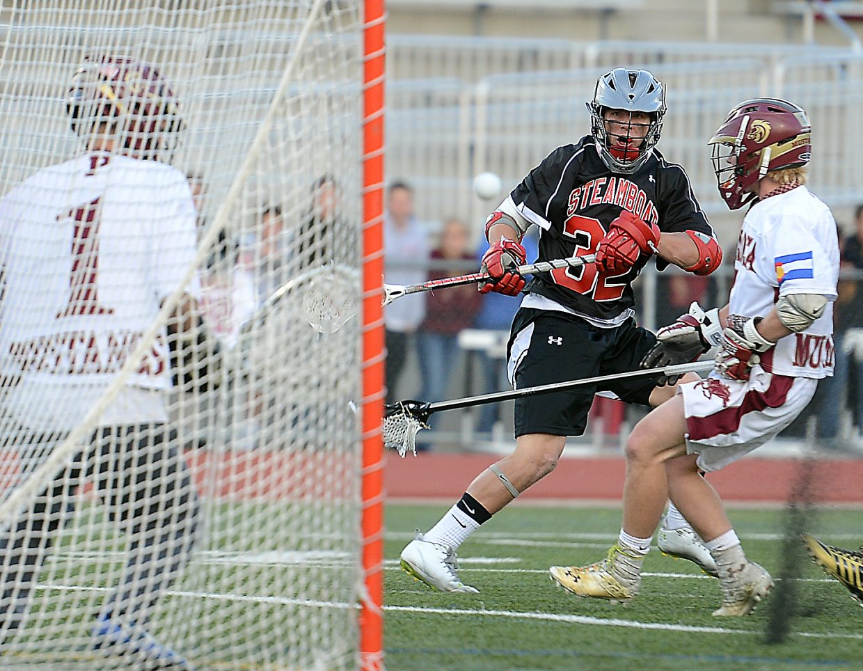 Steamboat's Mitch McCannon watches a shot fly toward the net after bouncing off the turf Wednesday.