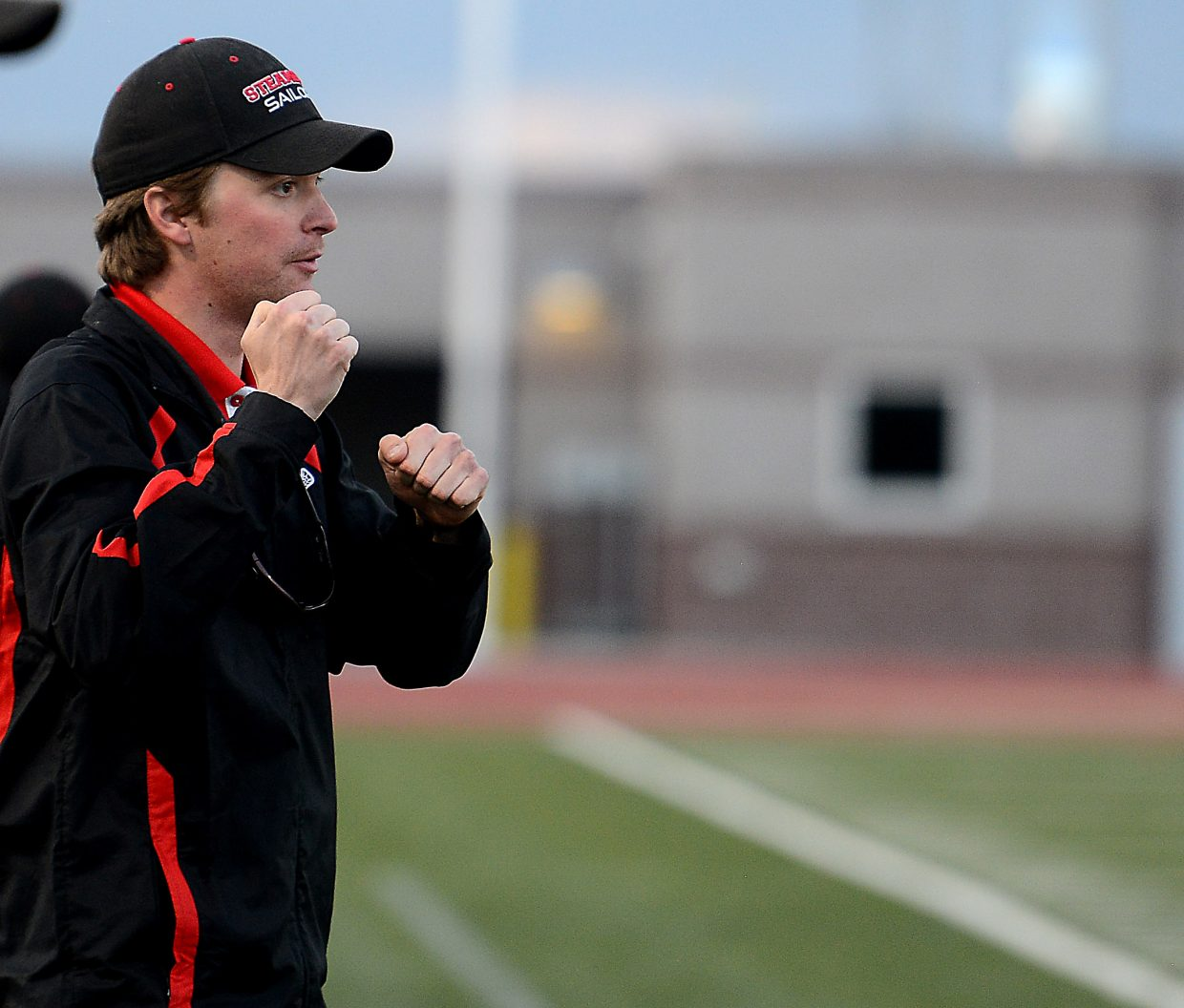 Steamboat coach Jay Lattimore cheers his team on Wednesday.