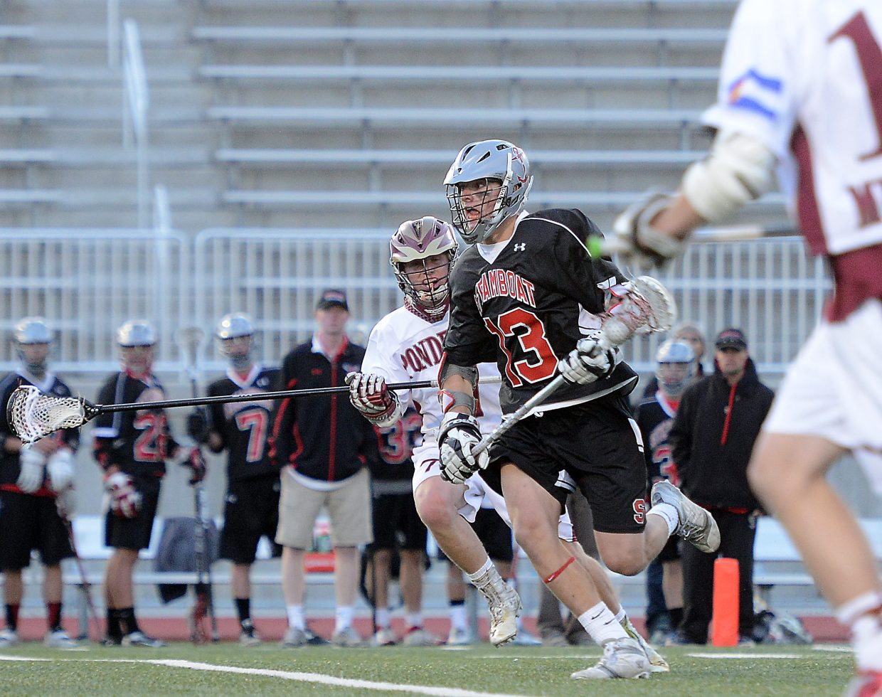 Steamboat's Jackson Perry races across the midfield Wednesday in the state tournament semifinal game.