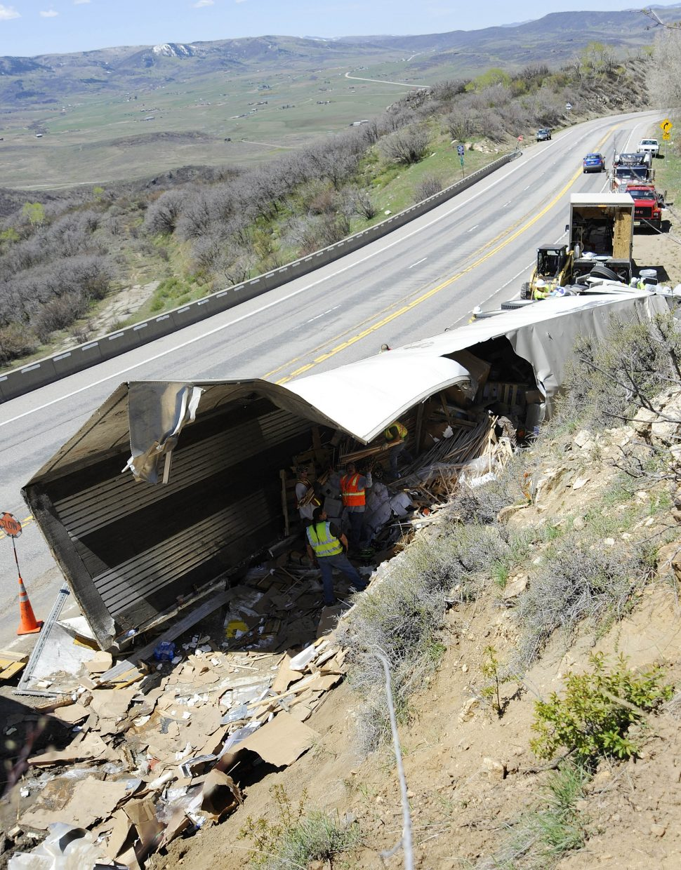 Workers remove items from a semi that rolled over Friday morning on U.S. Highway 40 on Rabbit Ears Pass. No one was injured in the crash.