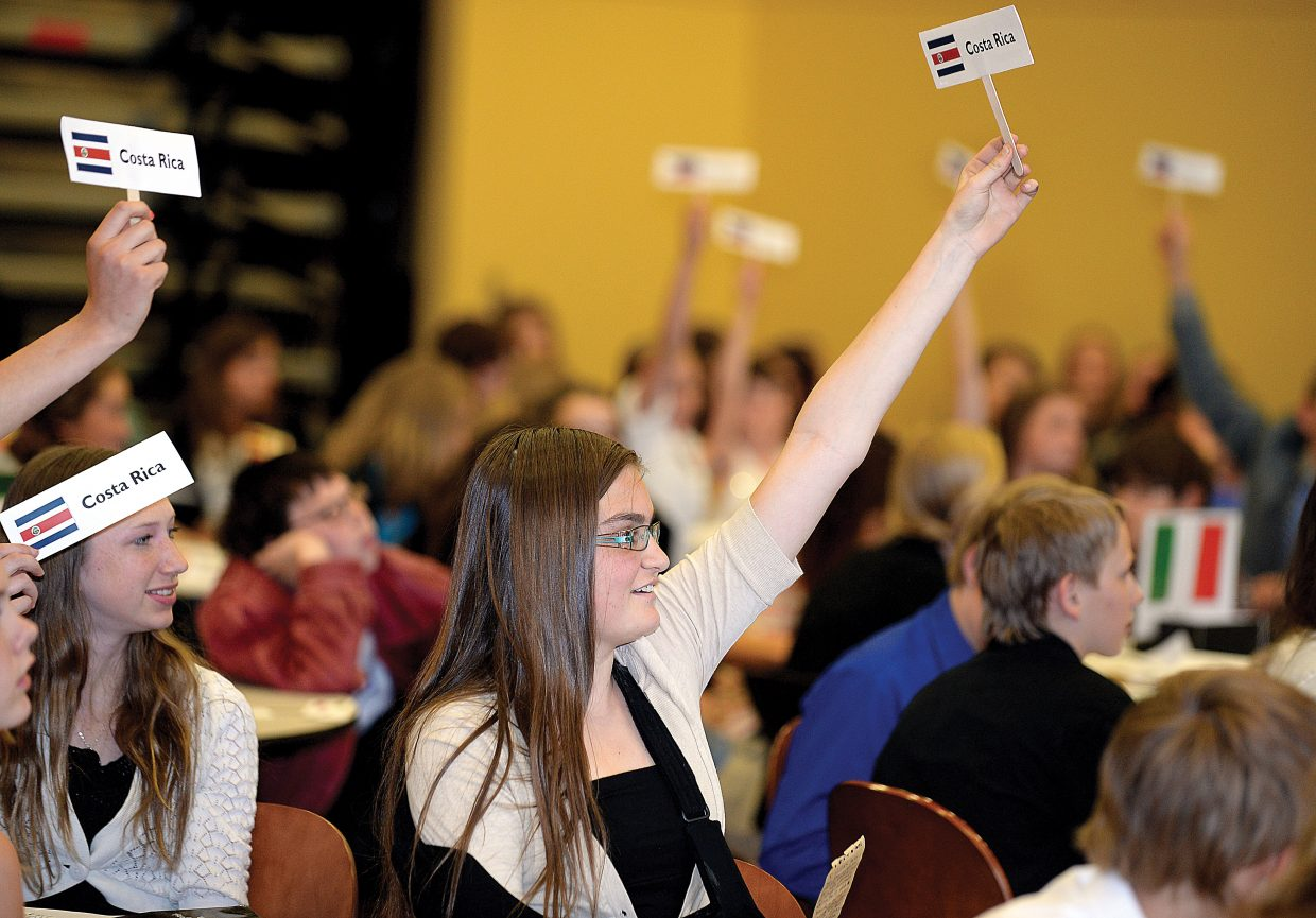 Steamboat Springs Middle School student Lauren Requist raises her country's card during a discussion about a resolution made during the general assembly during the second day of the Northwest BOCES third annual Colorado Model United Nations event at Colorado Mountain College. One hundred and seventy five students from seven school districts representing 28 nations took part in meetings to debate their resolutions on political, social and environmental world issues. High school students, who are part of a leadership class at Steamboat Springs High School, were the ambassadors, who moderate the debates.