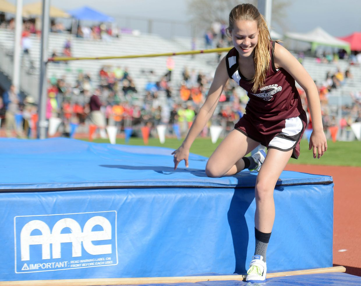 Kali Constine smiles wide after clearing the bar during Thursday's high jump competition at the state track meet.
