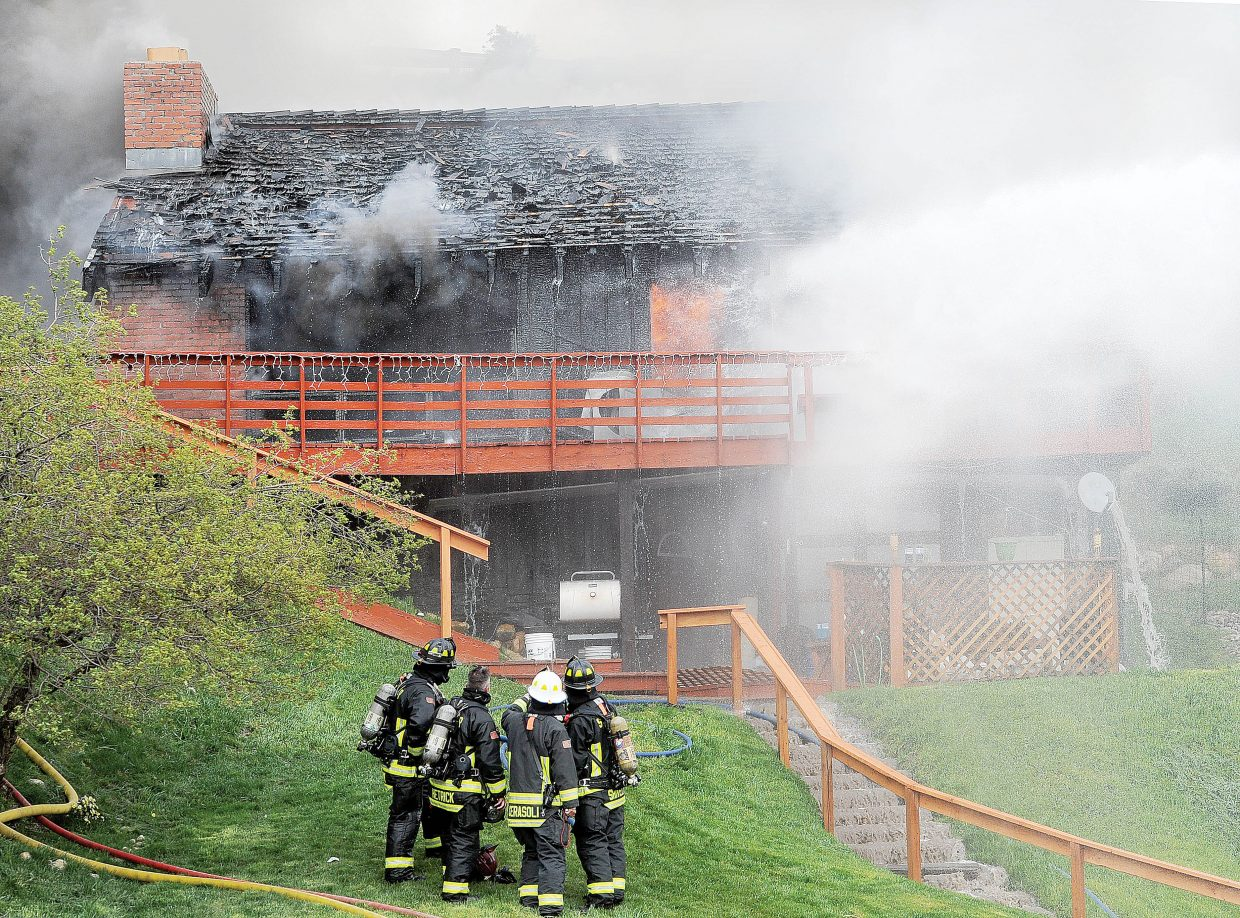 Members of Steamboat Springs Fire Rescue battle a blaze at a home on Apres Ski Way Thursday morning in Steamboat Springs.
