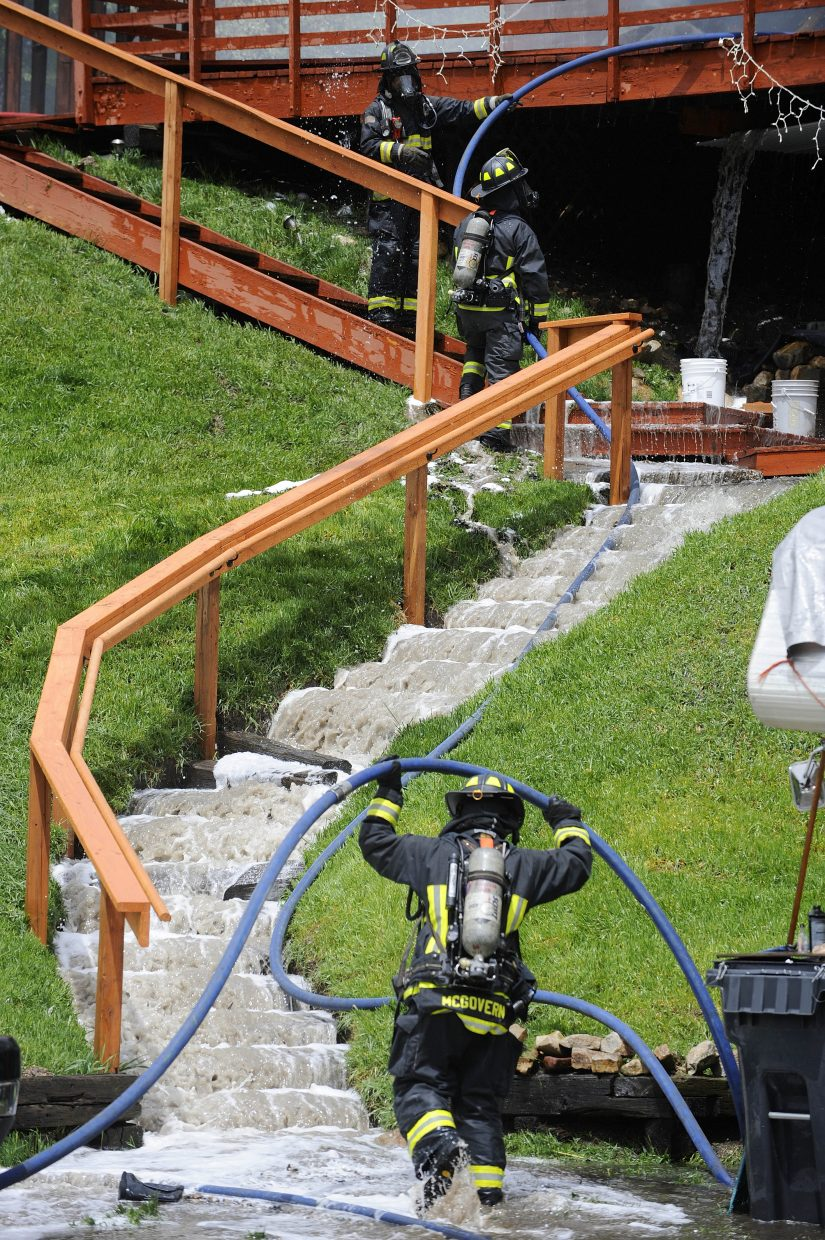 Water cascades down the steps at the Après Ski Way home.