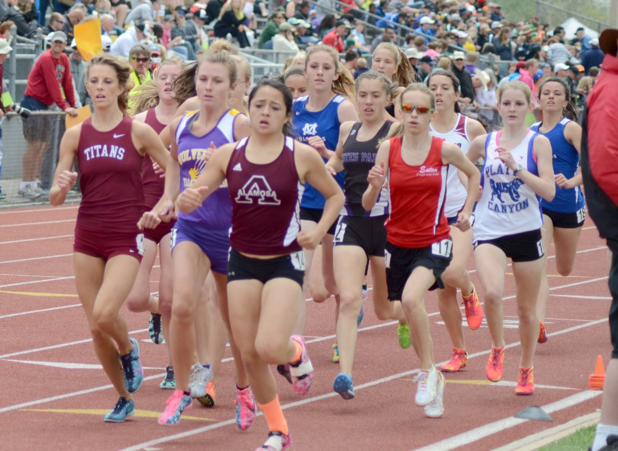 Mattie Jo Duzik, center, and Ary Shaffer, right, run in the 800-meter Friday at the state track meet. Duzik finished 13th and Shaffer 16th, with her best time of the season.