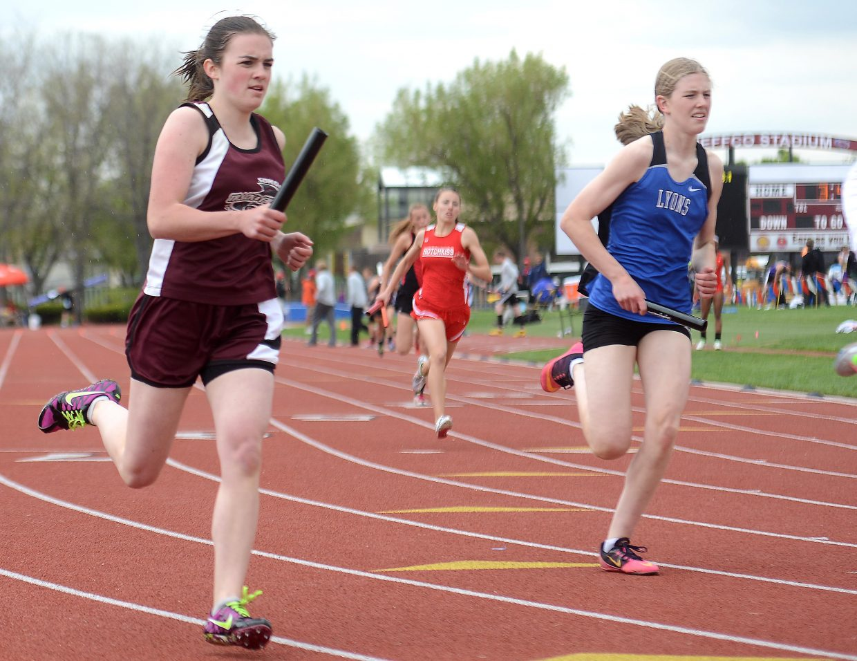 Hayley Johnson runs down the backstretch of her lap of the 1,600-meter relay on Friday at the state track meet in Lakewood.