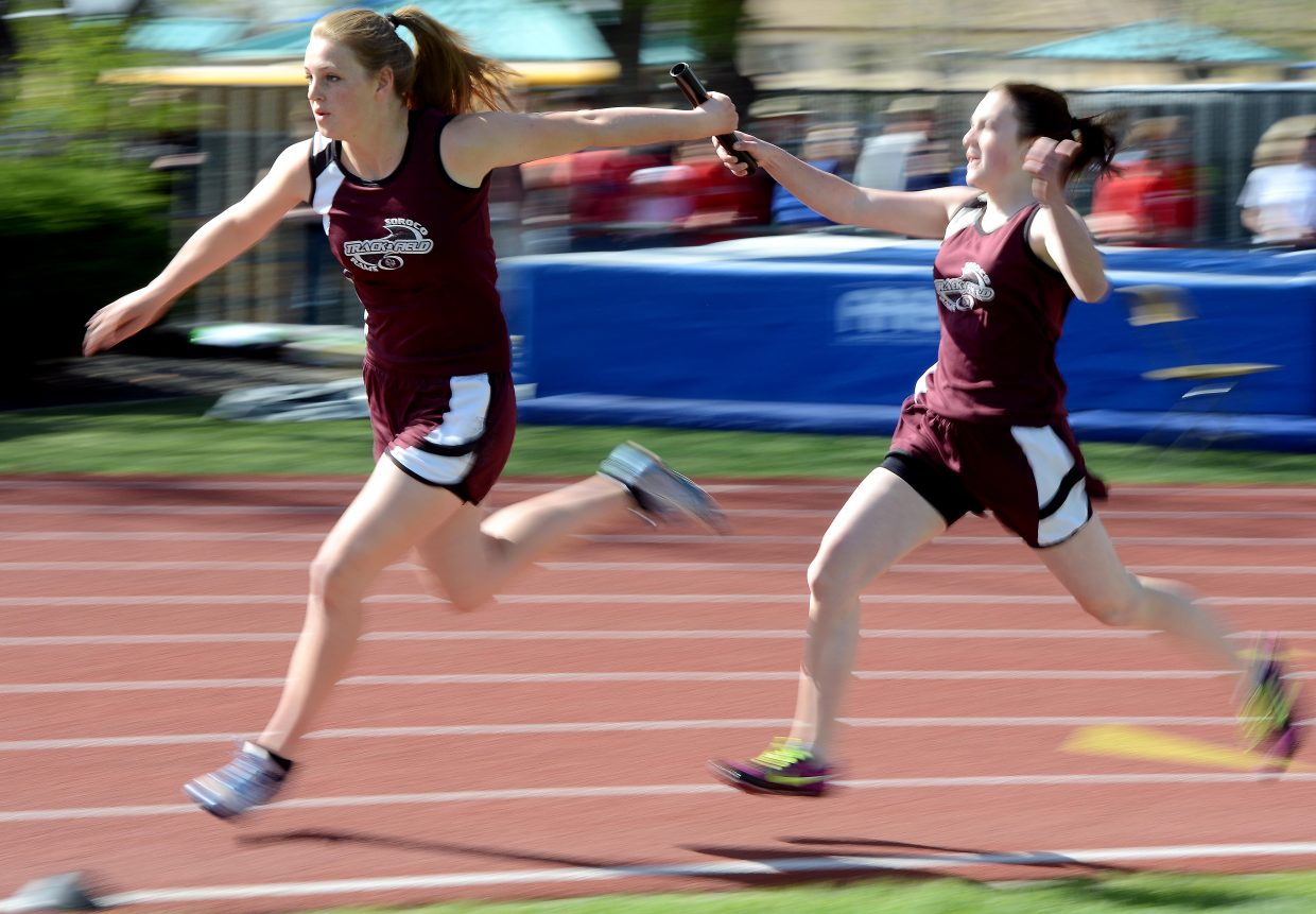 Soroco's Hayley Johnson hands the baton off to Jessica Rossi during the Class 2A girls 400-meter relay Friday at the state track meet in Lakewood. The Rams finished 15th in the event, bettering the time this season, but falling short of the finals.