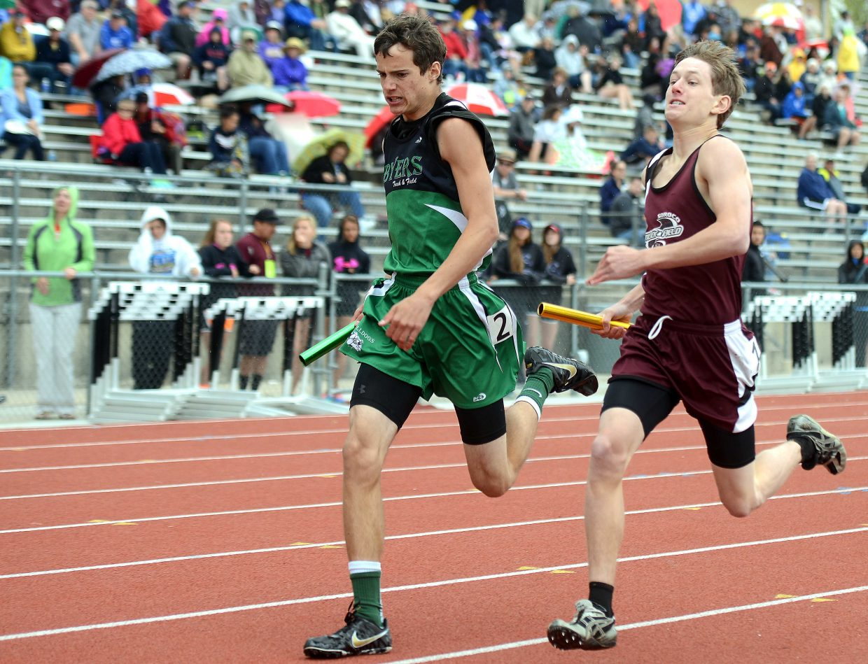Soroco's Andrew Herzog rumbles down the track in the anchor leg of the boys 1,600-meter relay on Friday.