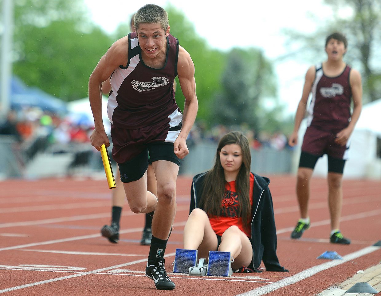 Chance Beaty takes off from his starting blocks during the boys, 1,600-meter relay Friday.