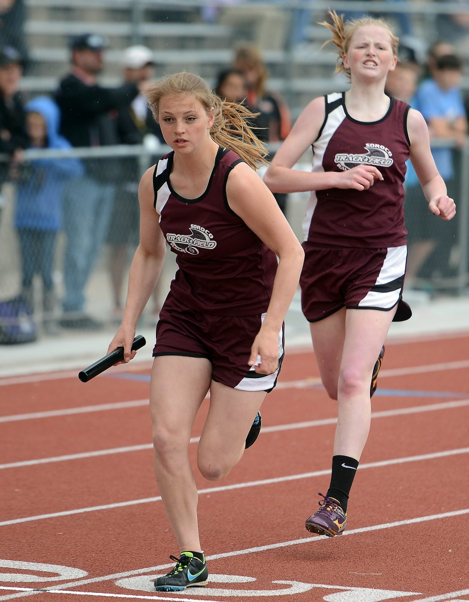 Leah Walorski watches after handing off the baton to Jessica Rossi during the 1,600-meter relay Friday.