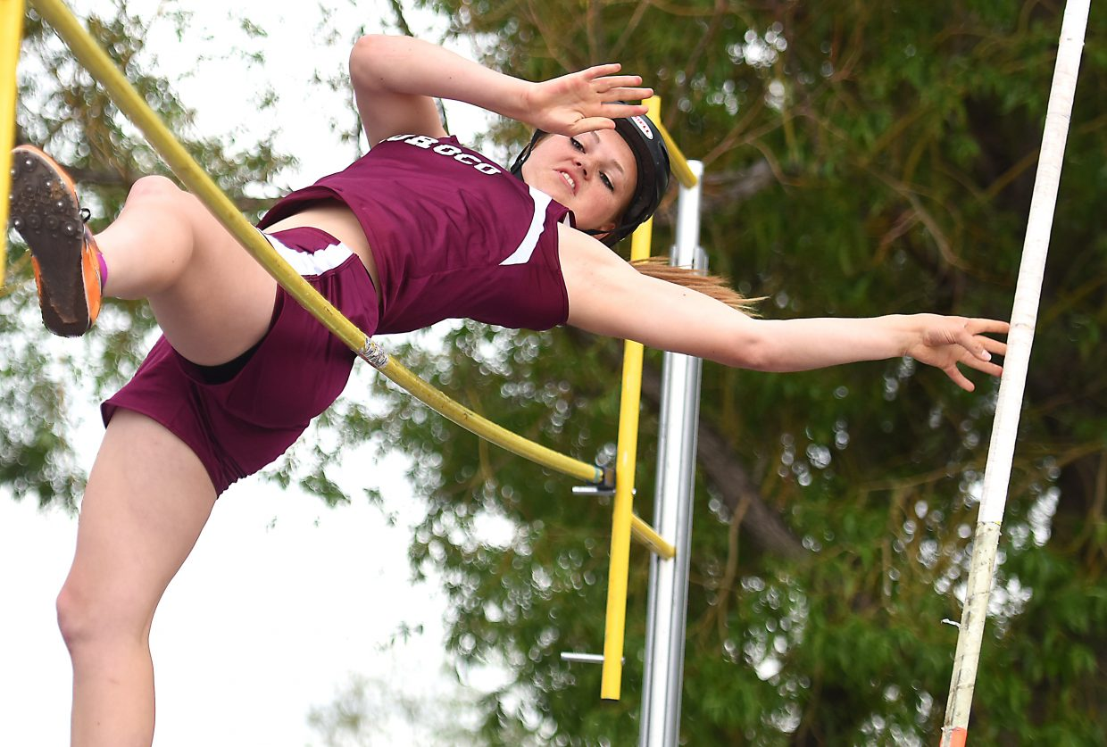 Jessica Rossi slides over the bar during Friday's Class 2A pole vault competition at the state track meet in Lakewood. She made it and went on to place third in the event. It was one of two medal-worthy performances she managed on the day. She also placed fourth in discus.
