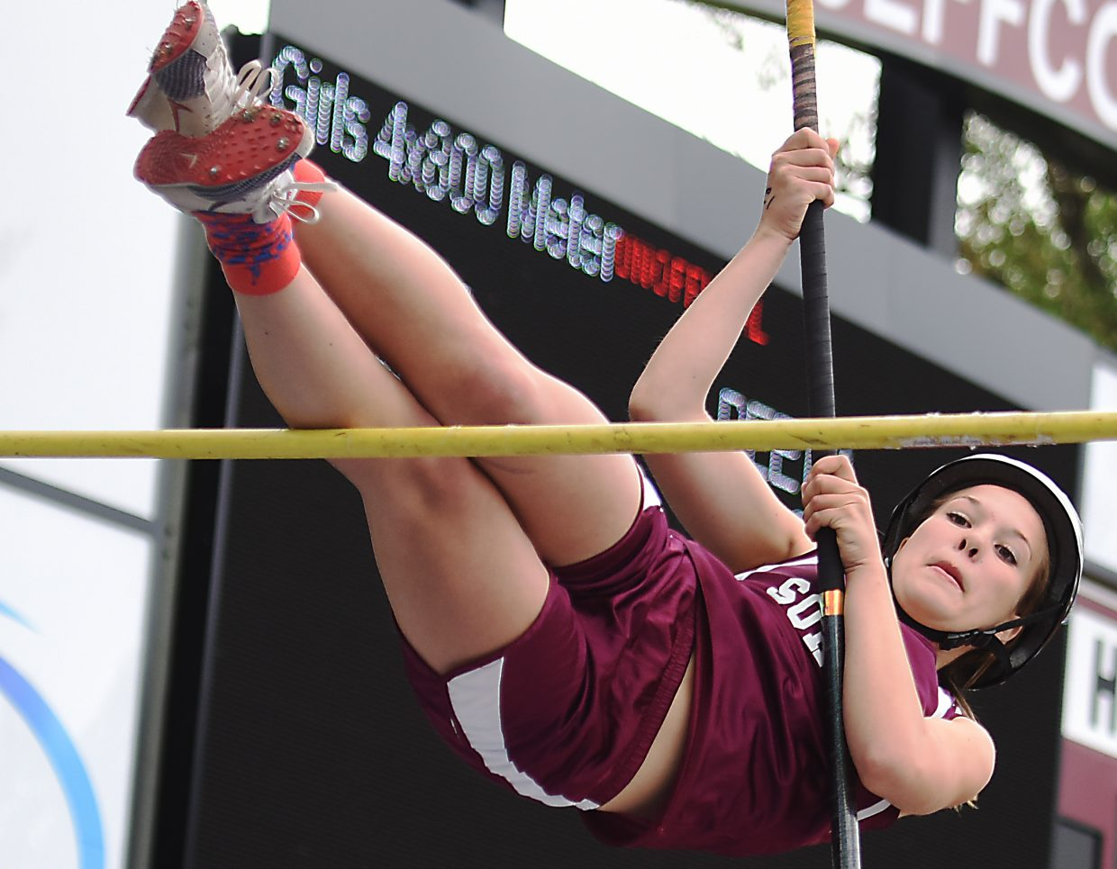 Kali Constine tries to get over the bar in pole vault at the Class 2A state track meet in Lakewood.