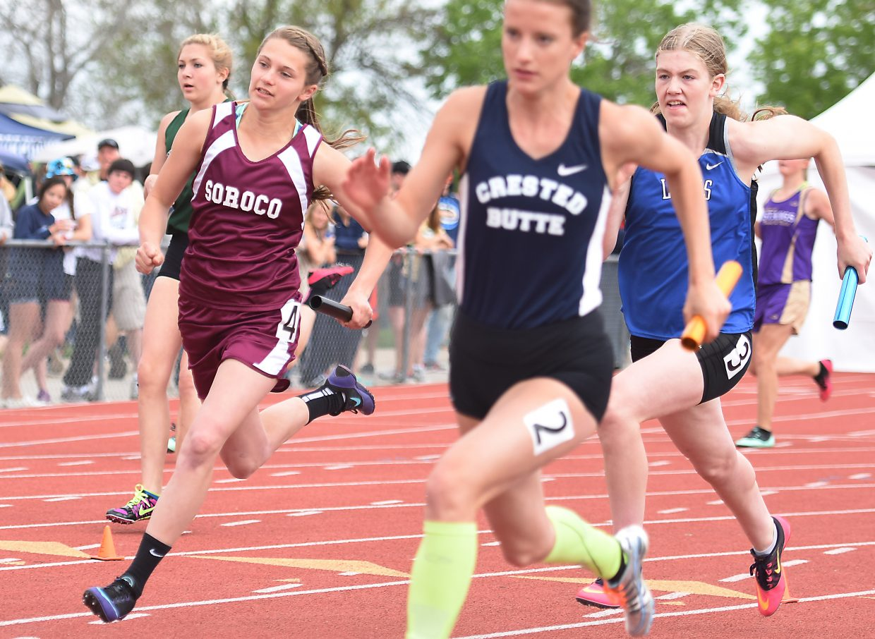 Mattie Rossi flies around the curve on the final leg of the girls 400-meter relay Friday at the state track meet in Lakewood.