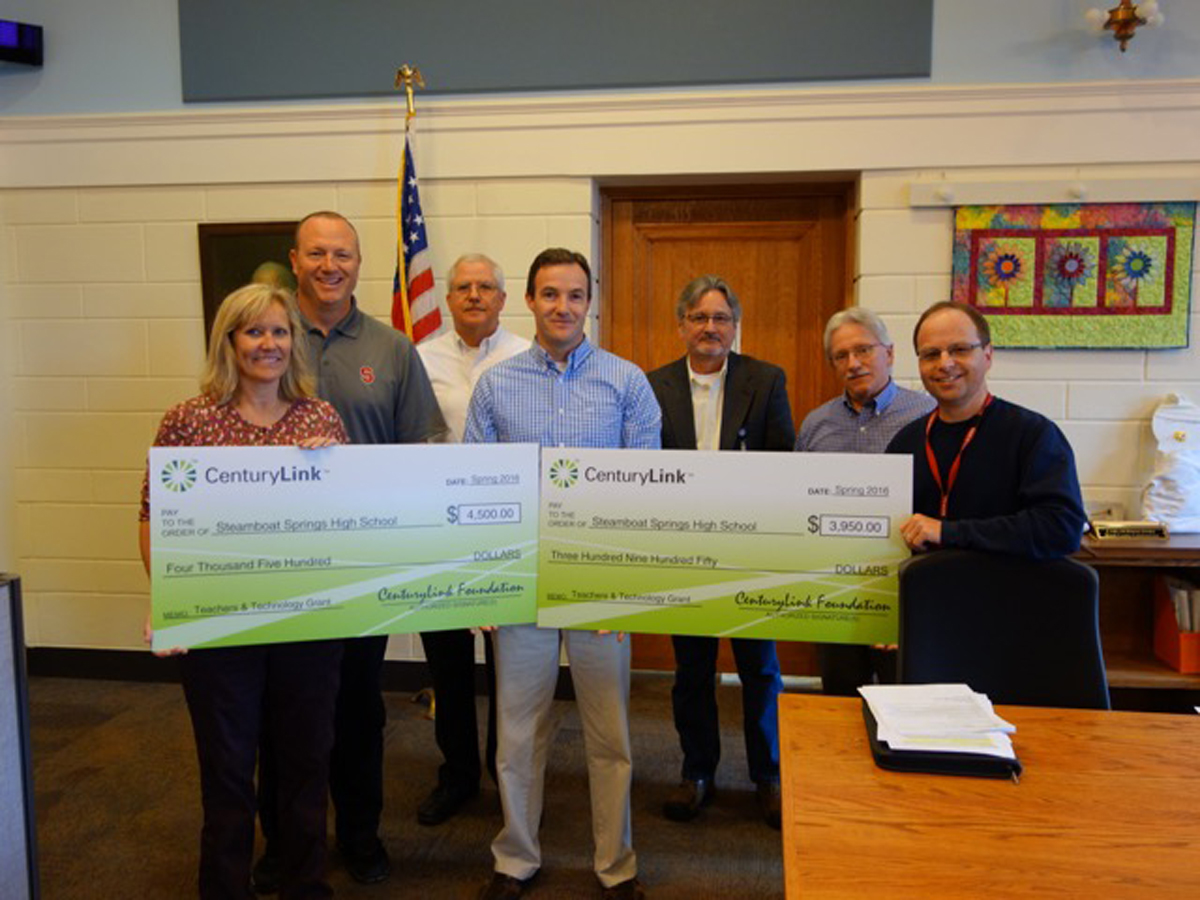 Steamboat Springs High School teachers Carole Buelter, far left, and Eric Nilsson, far right, were award a combined $8,450 from Century Link last week as part of the Teachers and Technology grant program. Buelter will use her grant to purchase a class set of Chrome Books to incorporate programming into math classes and for use for the Advanced Placement computer science class beginning this fall at SSHS. Nilsson plans to use his portion of the funds to purchase Vernier LabQuest devices to support hands-on learning through science labs, helping to bring scientific concepts to life for students.