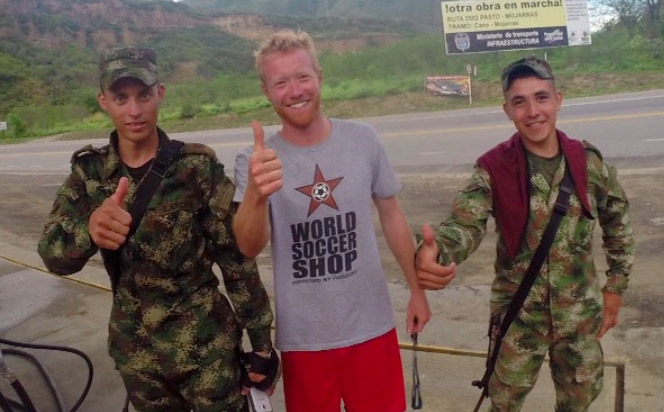Steamboat's Roddy Beall and Jordan Edwards get the green light from Colombian soldiers as they travel through this rugged mountain country.