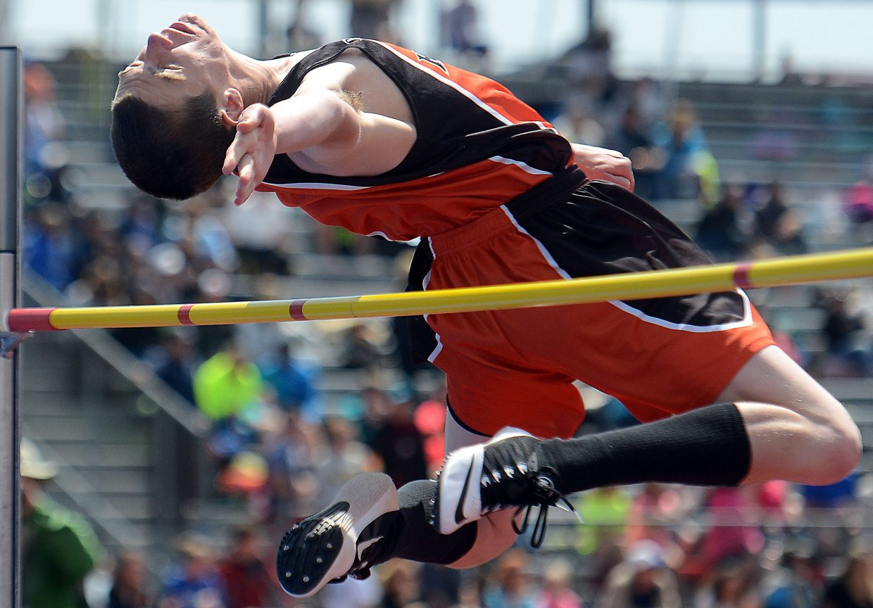 Hayden's Thomas Rauch curls around the bar Saturday at the state track meet in Lakewood. Rauch cleared the height but couldn't advance any further in the event.