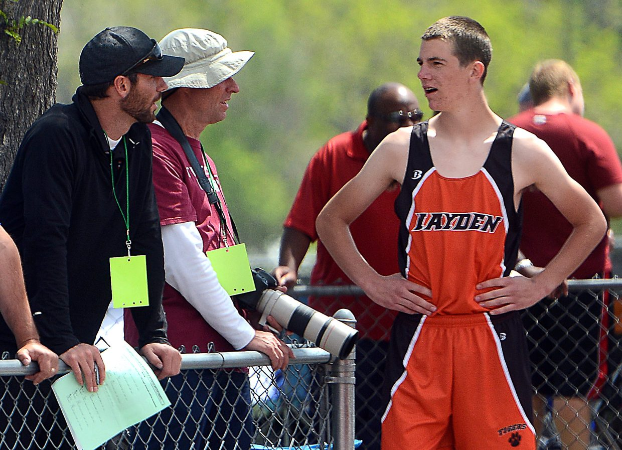 Hayden coach Patrick Moore consults with Thomas Rauch during Saturday's Class 2A high jump event at the state track meet.