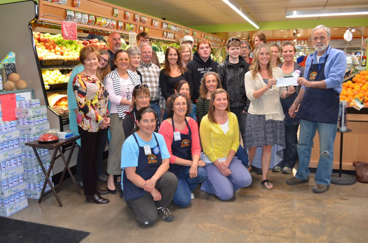 Natural Grocers in Steamboat Springs recently presented the Yampa Valley Autism Program with a check for $1,318, which represents a percentage of the store's total sales on National Autism Awareness Day, April 2. Tony Willemse, store manager, made the check presentation this past week to Lisa Lorenz, new executive director of YVAP. Also pictured are Natural Grocers nutrition coach Alicia McLeod, Jessica Reagon, Diane Maltby, Lorelei Ernst, Amanda Anzalone, Lu Etta Loeber, Betsy White, Holly Nelson, Jack Dysart, Ian White, Denise English, Kim Vogel, Don Vogel, Jack English, Sawyer Lorenz and Jim Lorenz as well as several other members of the Natural Grocers staff and YVAP clients and families.