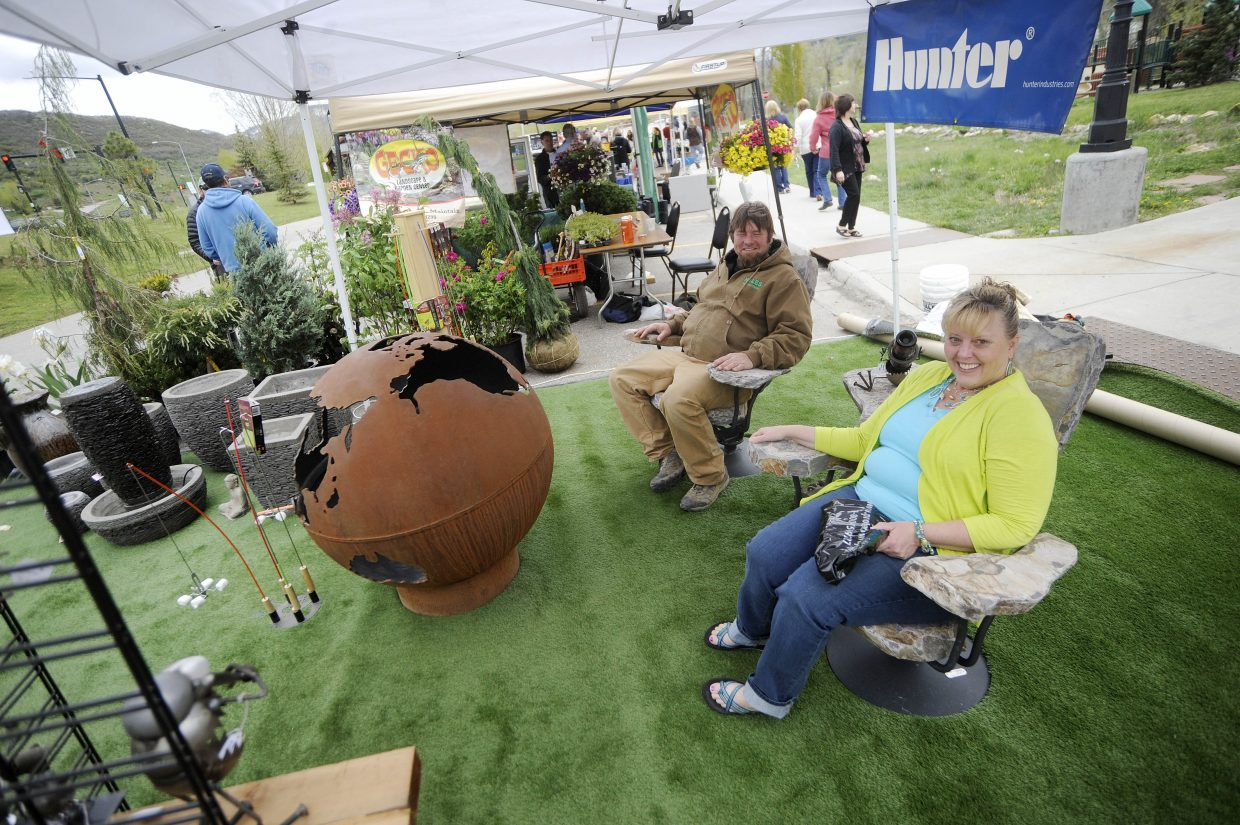 Teresa Urmeister tries out some stone furniture at the Hales Landscape Supply booth during the Steamboat Living Home and Garden Expo on Saturday at the Steamboat Springs Community Center.