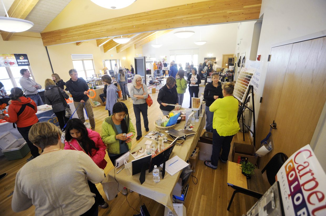 People visit booths during the Steamboat Living Home and Garden Expo on Saturday at the Steamboat Springs Community Center.