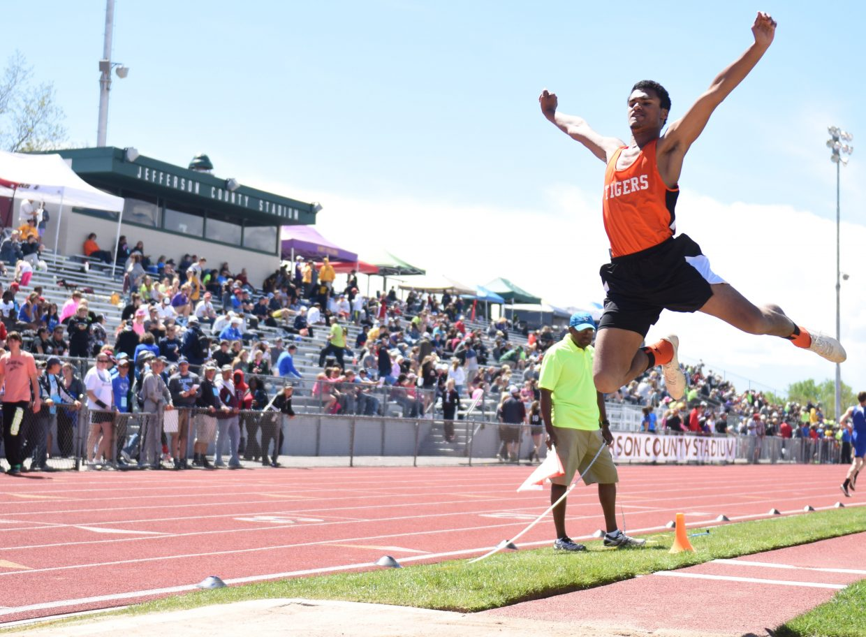 Hayden's Jack Redmond flies high in the long jump competition. He ended up fourth in the event, earning his second medal of the weekend.