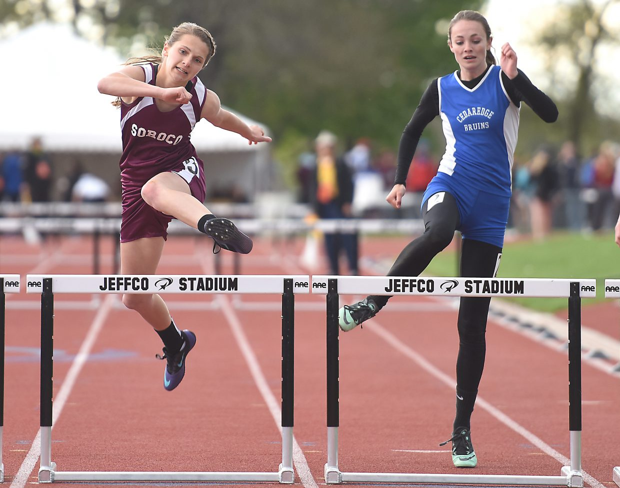 Soroco's Mattie Rossi clears the last hurdle during the 300-meter hurdles race Saturday at the state track meet in Lakewood. She placed seventh.