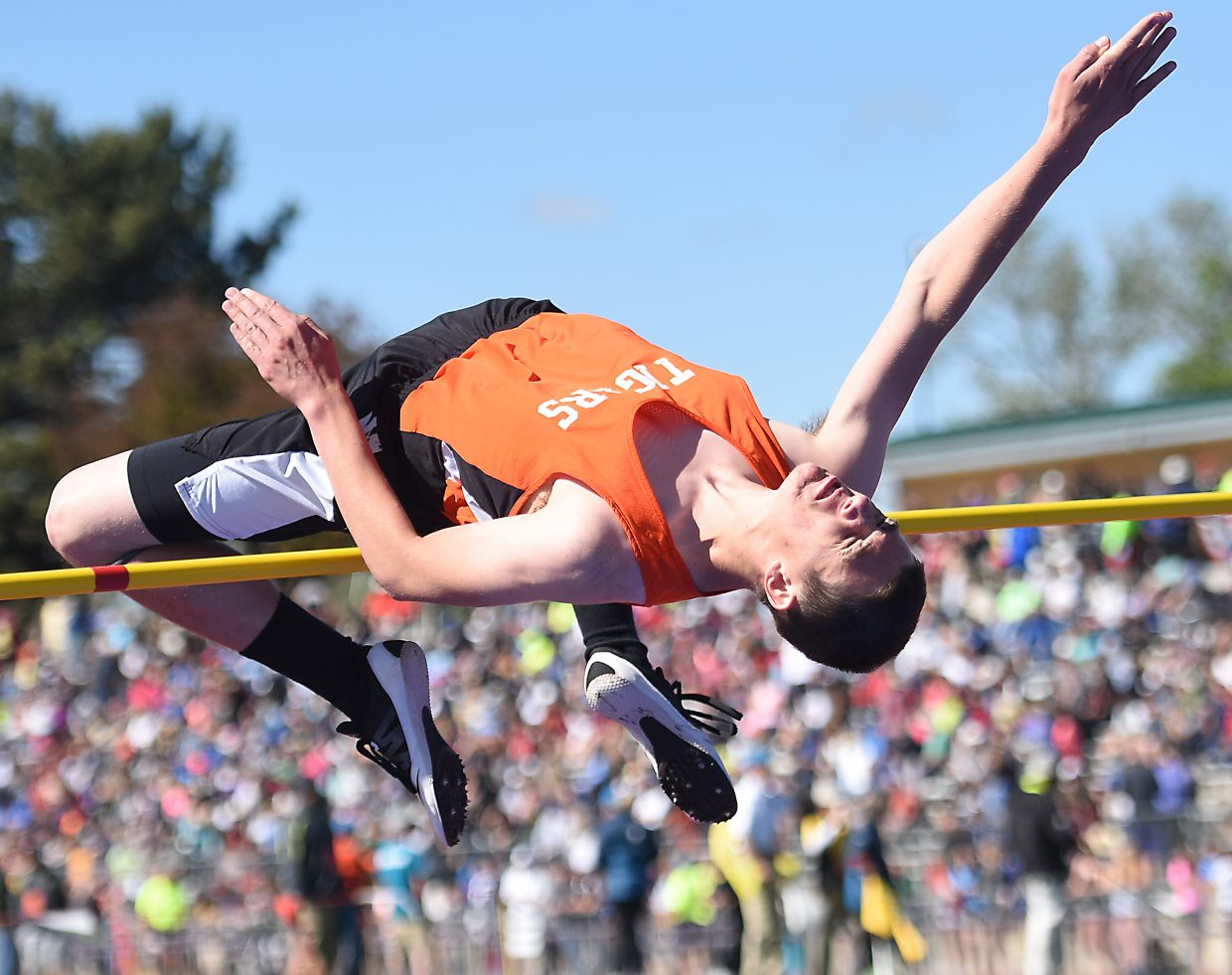 Thomas Rauch tries to bend over the bar during the boys high jump competition Saturday at the state track meet in Lakewood.