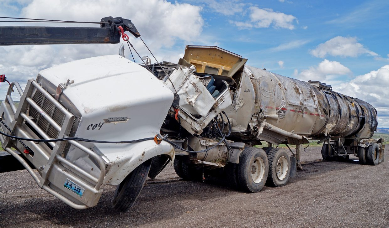 This Kenworth truck tractor pulling a 1978 Fruehauf tanker trailer loaded with 7,500 gallons of hot asphalt rolled and spilled part of its load Monday night. The driver, Jody Ramsey, was killed in the crash.