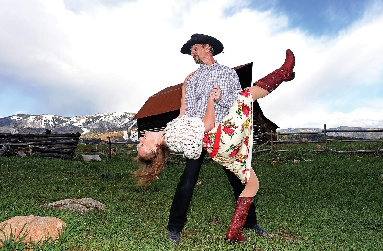 Amanda Leftwich and Don Miles dance in front of the More Barn in Steamboat Springs.
