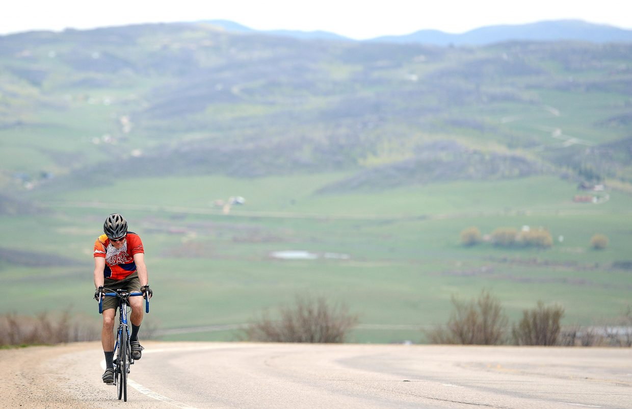 Steve Faulkner grinds his way up Rabbit Ears Pass on Sunday. Temperatures soared in Steamboat Springs, and there was no shortage of people getting out to enjoy the weekend weather.