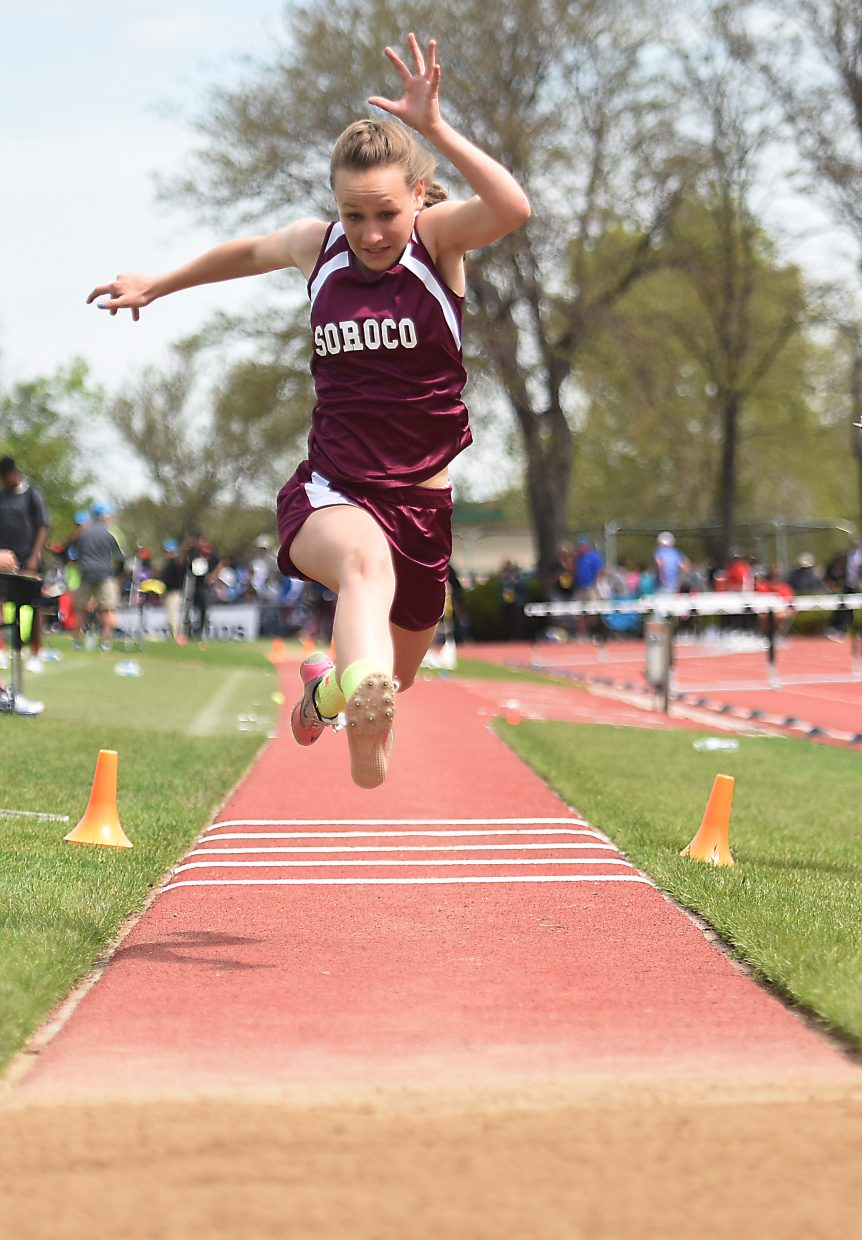 Cassie Constine takes a leap in the triple jump Friday at the state track meet in Lakewood. She placed eighth in the event.