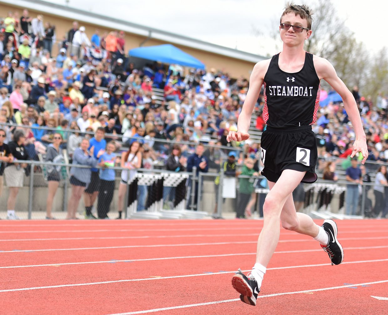 Steamboat Springs freshman Jon Ruehle runs Friday at the state track meet.
