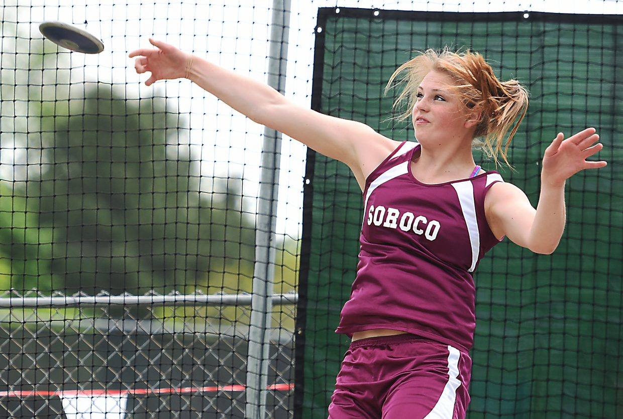 Jessica Rossi lets go of the discus Friday at the state track meet in Lakewood. Rossi placed fourth in the event.