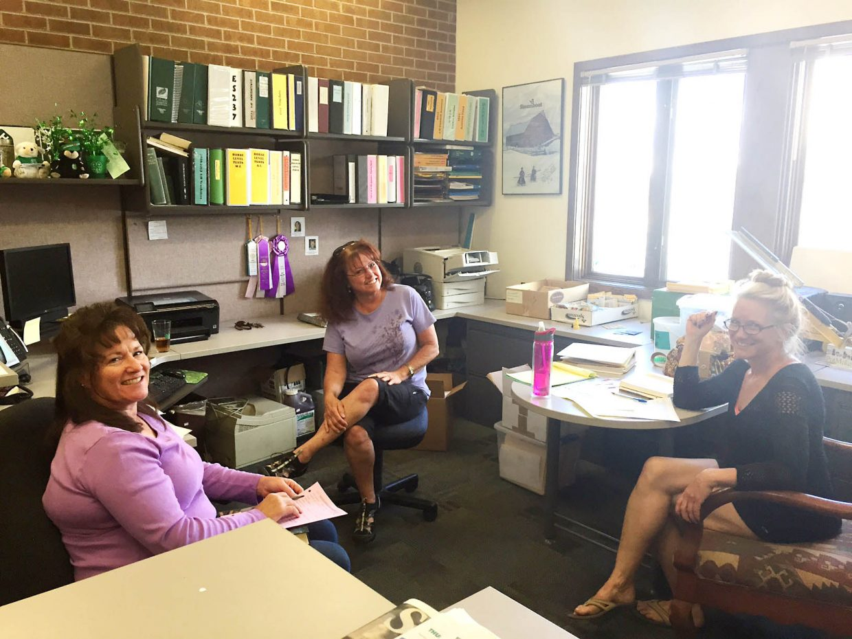 From left, Susann Allen and Donna Segale visit with a client during Colorado Master Gardeners' office hours last summer at the Routt County Extension office.
