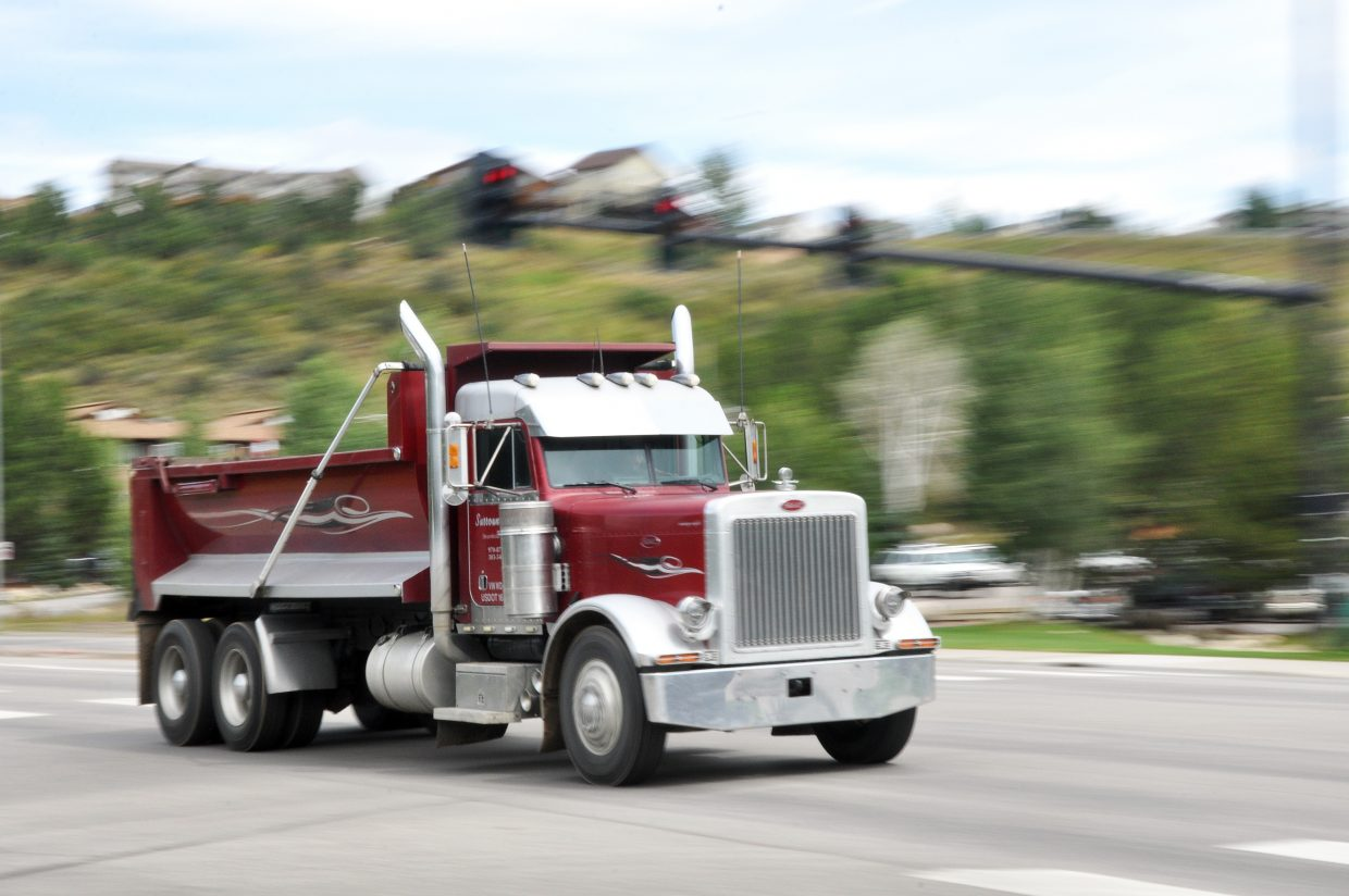 A commercial truck cruises down U.S. Highway 40 in Steamboat Springs. Commercial drivers will start to face more rigorous health exams starting Wednesday as a result of new federal rules.
