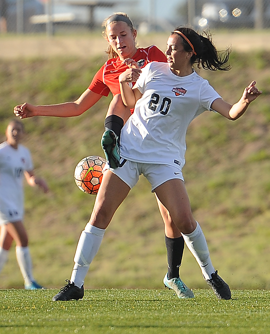 Steamboat's Brooke Buchanan tries to kick her way to the ball Thursday against Lewis-Palmer.