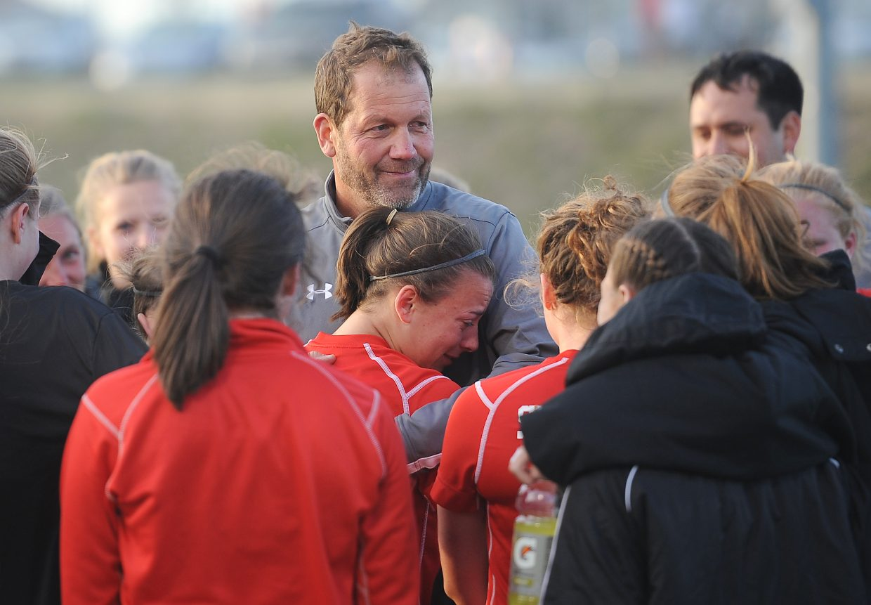 Steamboat coach Rob Bohlmann offers some comfort to his team after the Sailors lost, 3-0, in the quarterfinal round of the playoffs against top seed Lewis-Palmer.