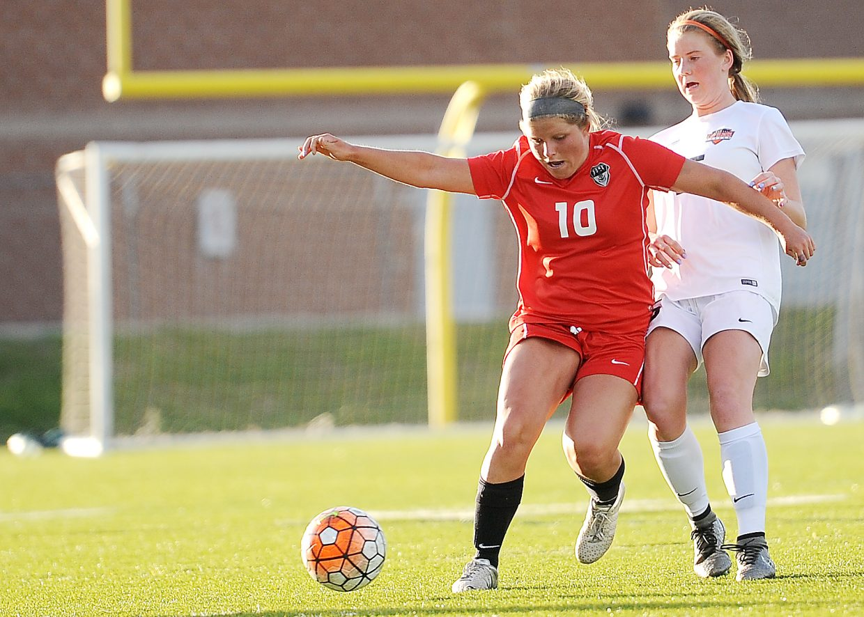 Steamboat's Ellese Lupori fights for a ball Thursday against Lewis-Palmer.