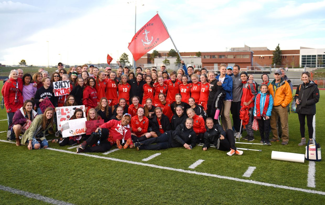 Steamboat Springs girls soccer players, coaches and fans pose after Thursday's 3-0 quarterfinals playoff loss at Lewis-Palmer.
