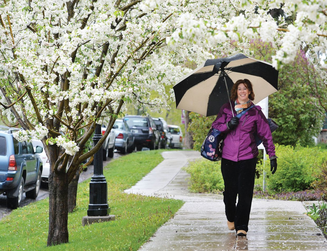 It appears by her smile that E.B. Mullen hasn't let the daily rain in Steamboat Springs bother her too much. On Tuesday, she used an umbrella to shield her from a steady stream of rain while walking along Oak Street in downtown.