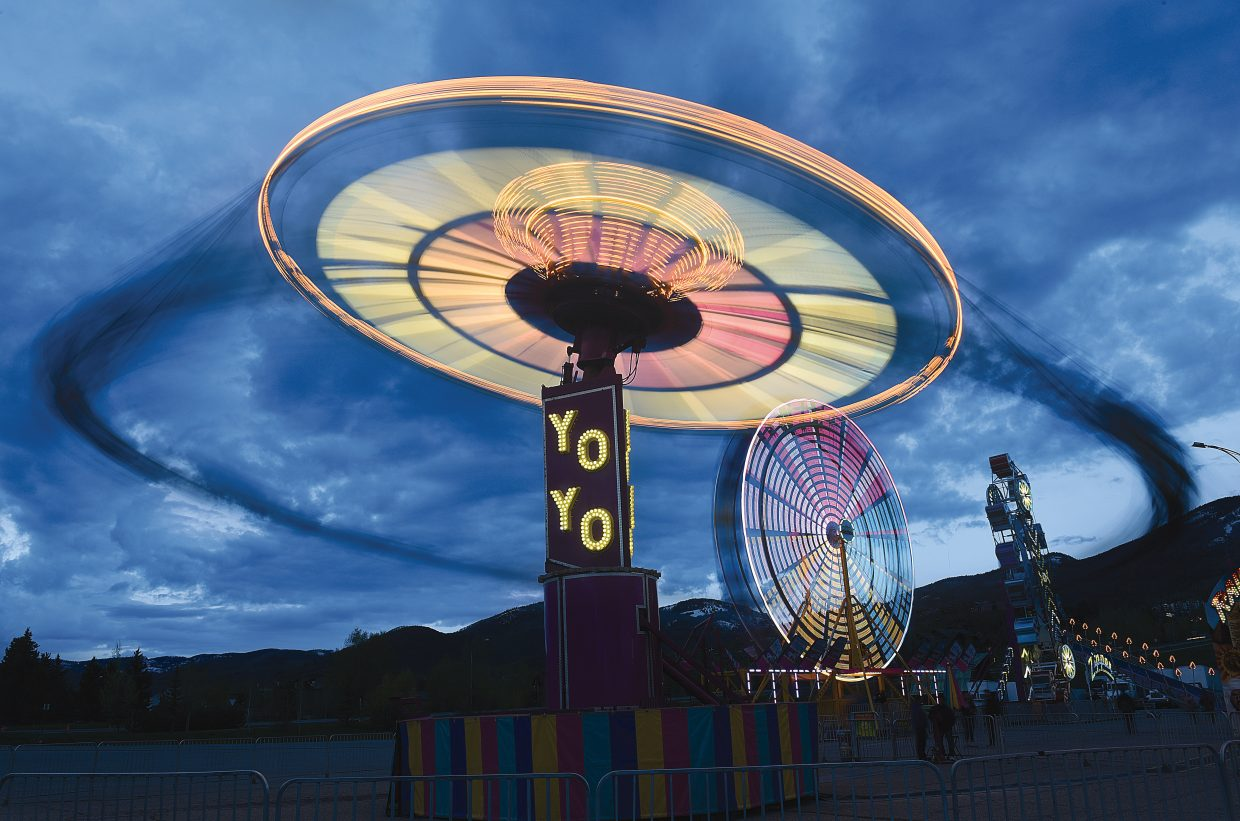 The annual Spring into Summer Carnival returned to the Meadow Parking lot Thursday evening, drawing those looking for a good time with the bright lights on many of the most popular attractions. The annual event, which is in it's eighth year in Steamboat Springs, is a fundraiser for the Steamboat Springs Middle School and is put on by the Parent information Committee and Brown's Amusements, which share in the carnival's profits.
