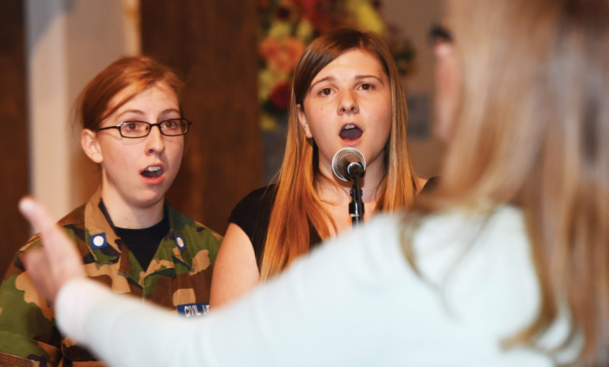 """Singers Andrea Houston (left) and Paige Eivins rehearse with The Steamboat Chamber Singers earlier this week. The group's """"Ireland's Call"""" concert, set for Friday and Saturday at St. Paul's Episcopal Church, will feature several guest performers."""