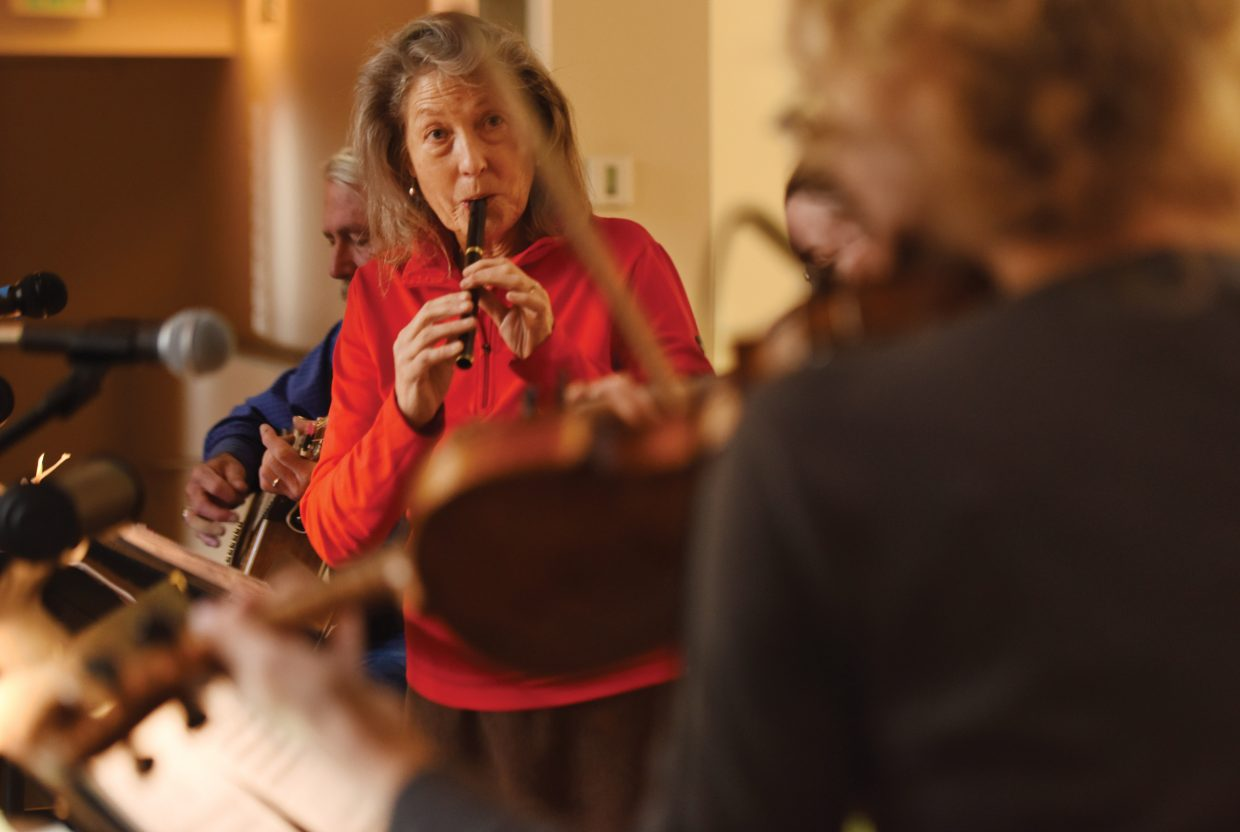 """Mary Beth Norris plays a penny whistle while rehearsing with the Steamboat Chamber Singers earlier this week. The group's """"Ireland's Call"""" concert, set for Friday and Saturday at St. Paul's Episcopal Church, will feature several guest performers."""