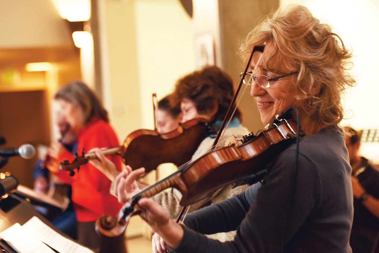 """Violinist Bonnie Murray lays down an Irish tune as she rehearses with The Steamboat Chamber Singers earlier this week. The group's """"Ireland's Call"""" concert, set for Friday and Saturday at St. Paul's Episcopal Church, will feature several guest performers."""