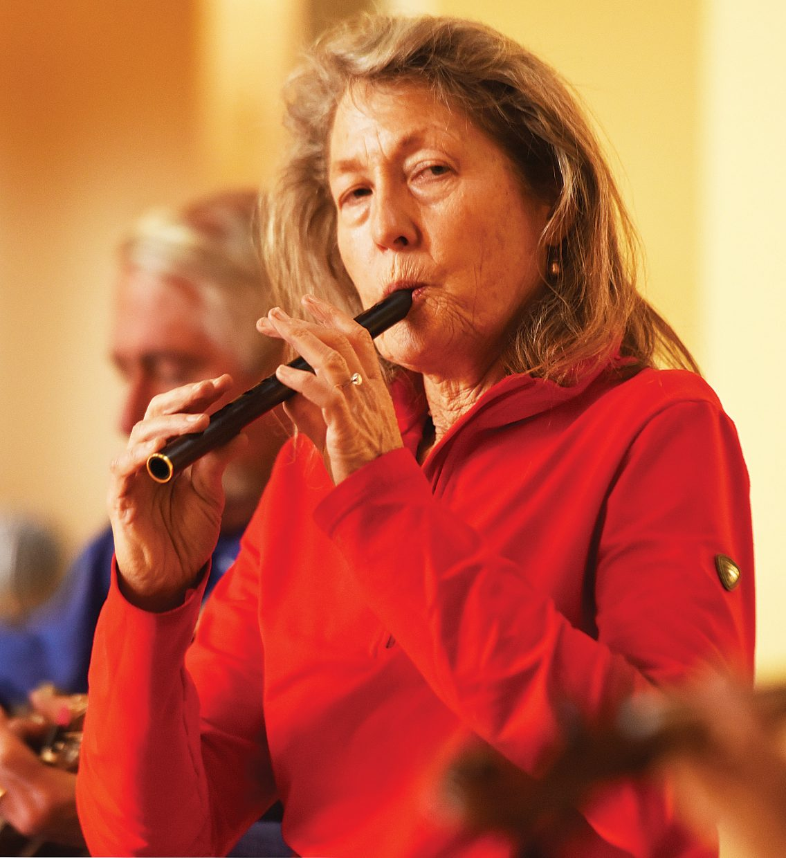 """Mary Beth Norris plays a penny whistle while rehearsing with the The Steamboat Chamber Singers earlier this week. The group's """"Ireland's Call"""" concert, set for Friday and Saturday at St. Paul's Episcopal Church, will feature several guest performers."""