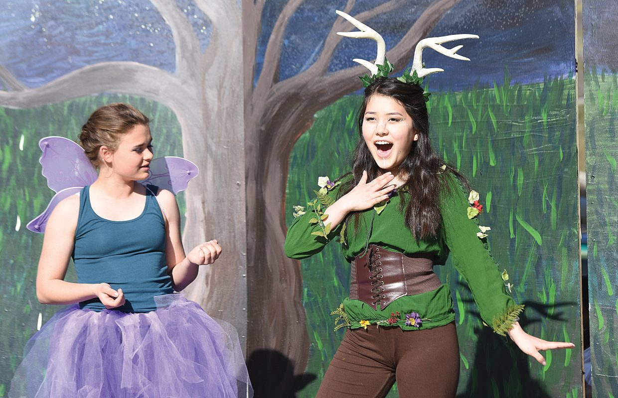 """Sammi Lee, who portrays Puck in the Steamboat Springs High School's production of """"A Midsummer Night's Dream,"""" rehearses a scene on a stage set up in front of the high school. The shows are scheduled for 5 p.m. Friday and Saturday. There will also be a show at noon Saturday."""