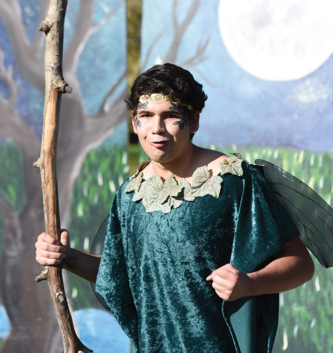 """Ernesto Saenz, who portrays Oberon in the Steamboat Springs High School's production of """"A Midsummer Night's Dream,"""" rehearses a scene on a stage set up in front of the Steamboat Springs High School. The shows are scheduled for 5 p.m. Friday and Saturday. There will also be a show at noon Saturday."""