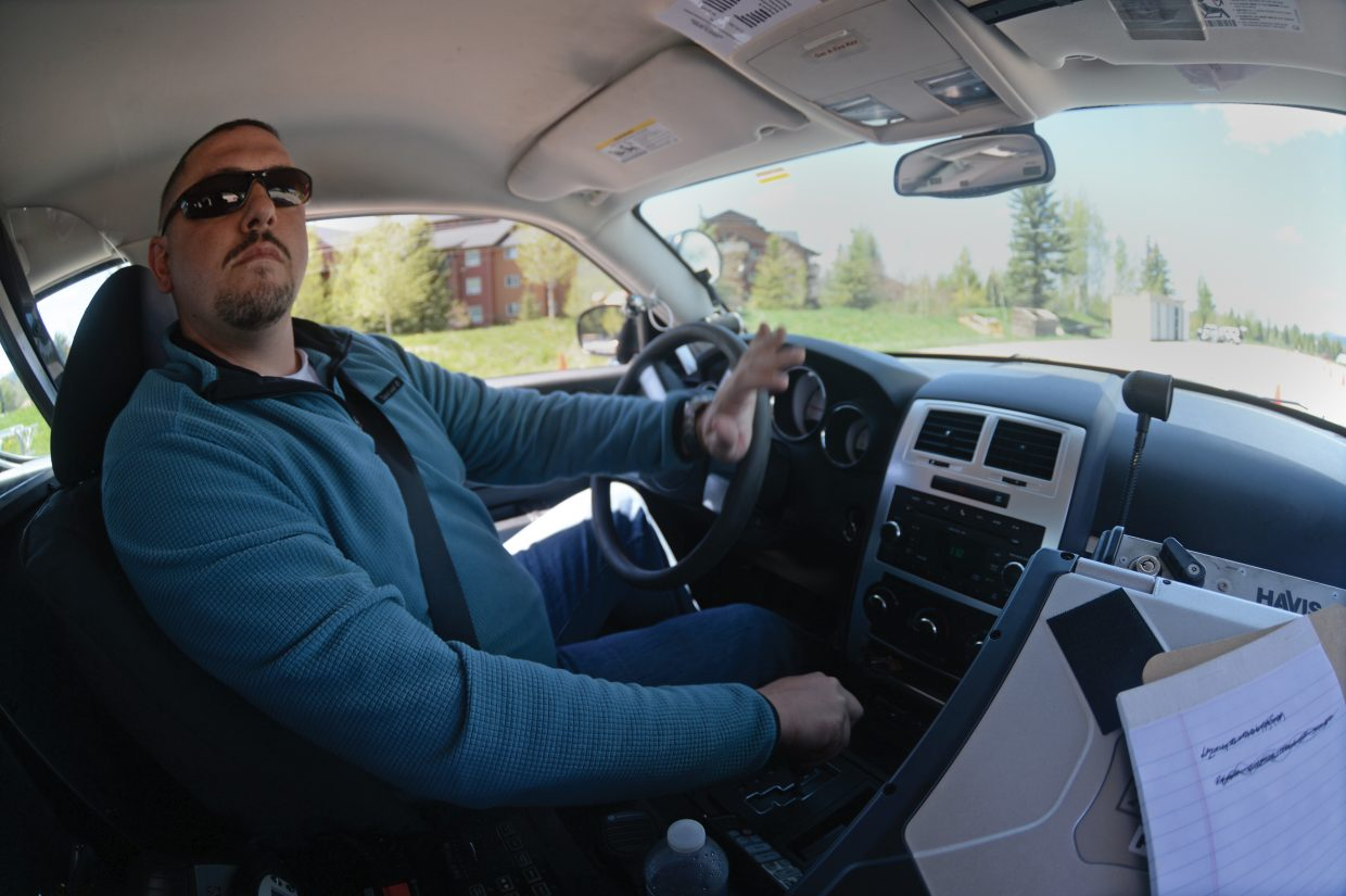 Steamboat Springs police officer Nick Moore navigates an obstacle course backward as part of the department's biannual training program. Officers with the Steamboat Springs Police Department go through routine drivers training in the spring and the fall.